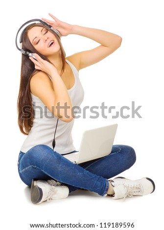 Young girl listen music by headphones isolated