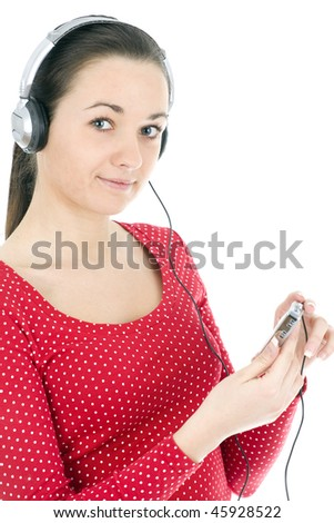 Young girl listening music from mp3 player. White background. - stock photo