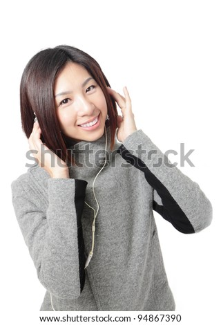 Young Girl listening music in headphones, isolated on white background, model is a asian beauty - stock photo
