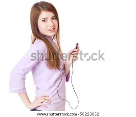 Young girl listening to music om mp3 player. Isolated on white background - stock photo