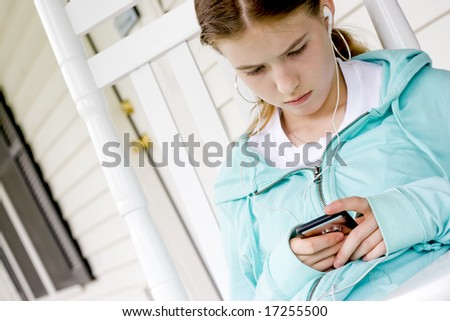 Young girl listening to music on her MP3 Player.