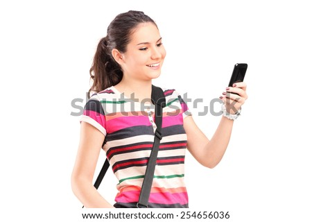 Young girl looking at a cell phone isolated on white background - stock photo