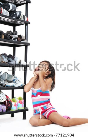 young girl looking at the stacks of shoes