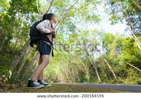 Young girl looking natural on the hiking trails