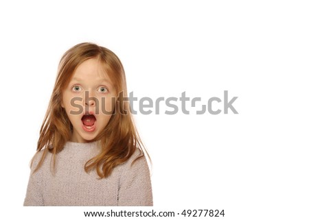 Young girl looking surprised - stock photo