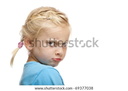 Young girl looks angry and offended in camera. Isolated on white background. - stock photo
