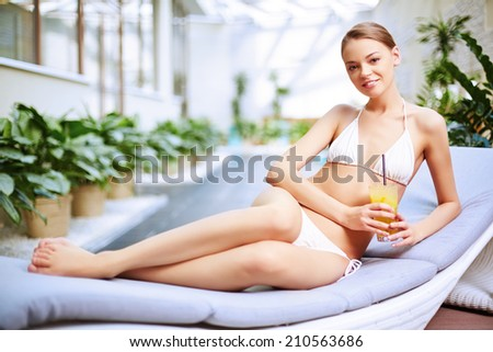 Young girl lying at swimming pool
