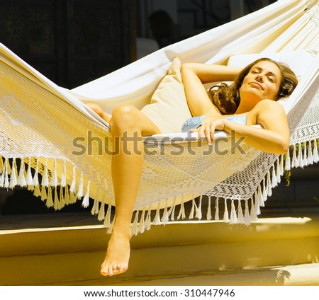young girl lying in a hammock - stock photo