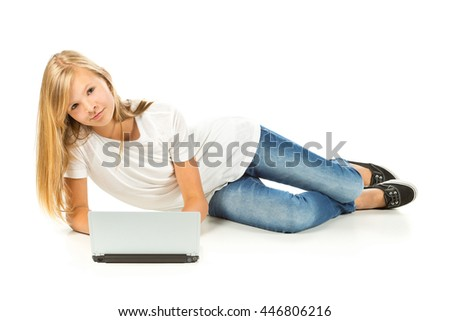 Young girl lying on the floor using laptop over white background - stock photo