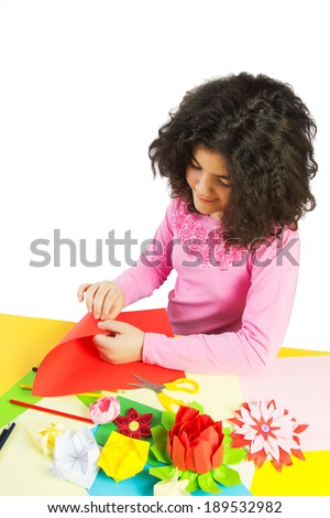 Young Girl Making Decorations with Colorful Paper. Isolated on White. - stock photo