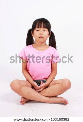 Young Girl Meditating - stock photo