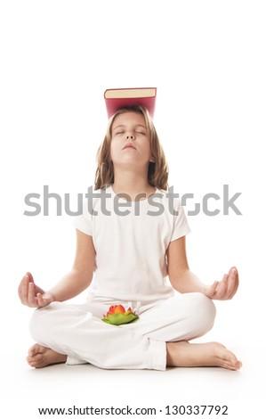 Young girl meditating with red book - stock photo