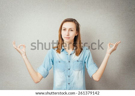 young girl meditation gesture.  - stock photo