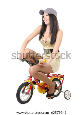 Young girl on a children's bicycle, isolated on withe background - stock photo