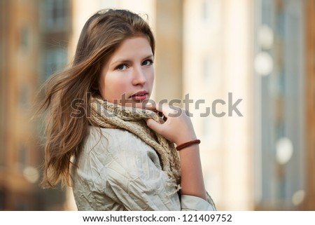 Young girl on a city street - stock photo