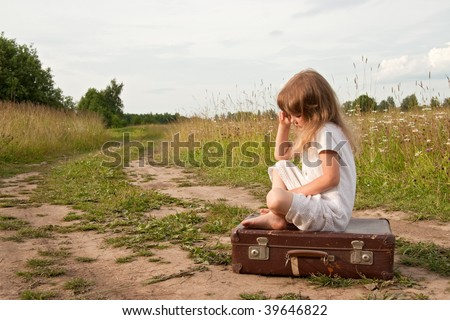 Young girl on rural  road - stock photo