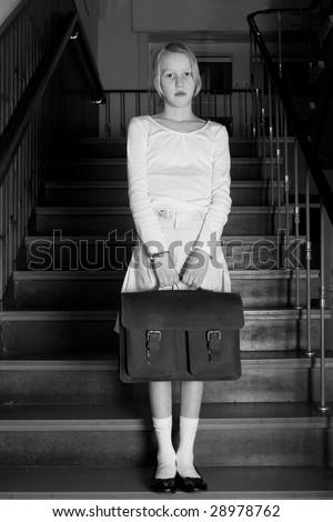 Young girl on school with a old school outfit - stock photo
