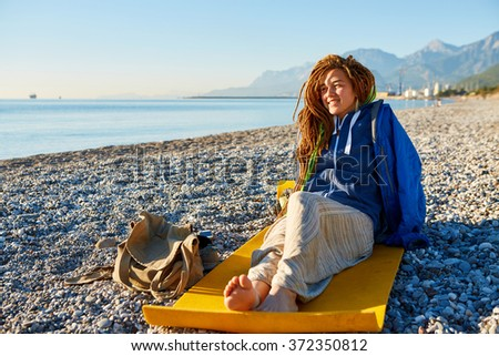 young girl on the beach - stock photo