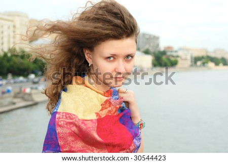 Young girl on the bridge over river - stock photo