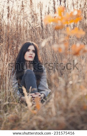 Young girl outdoor in autumn scenery - stock photo