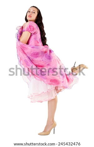 Young girl overhears. Portrait of attractive sexy girl in pink dress looking up at camera, isolated over white background.
