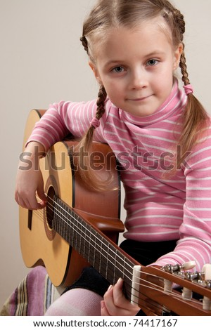 Young girl play classical guitar - stock photo