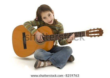 young girl playing acoustic guitar