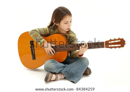 young girl playing acoustic guitar isolated on white background