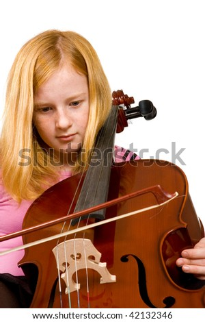Young girl playing cello isolated on a white background
