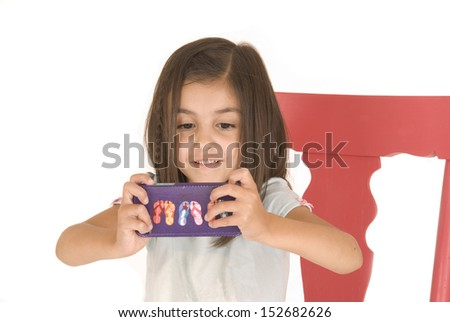 Young girl playing game on cell phone - stock photo