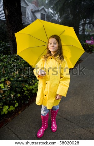 Young girl playing in rain 8 - stock photo