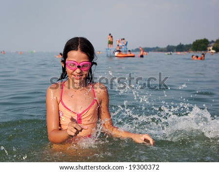 Young girl playing in the water - stock photo