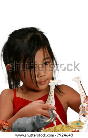 Young girl playing with animals - stock photo