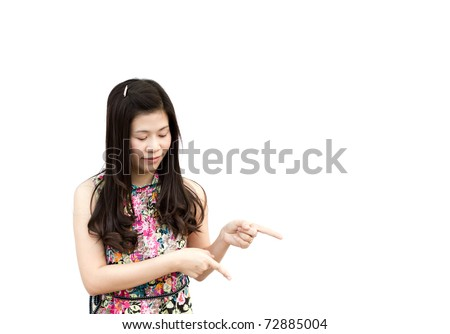 Young girl pointing down, isolated on white background.