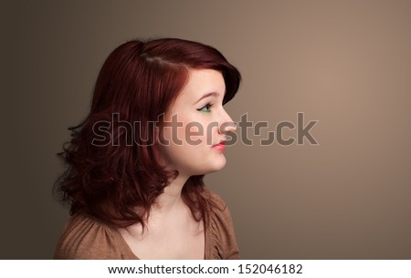 Young girl portrait thinking with plain copyspace - stock photo