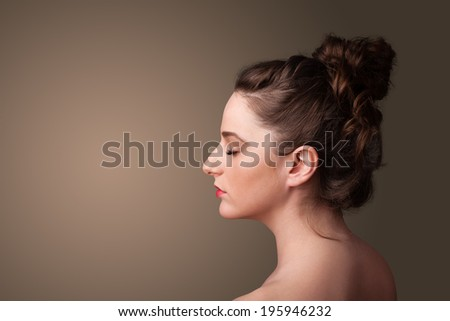 Young girl portrait thinking with plain copyspace