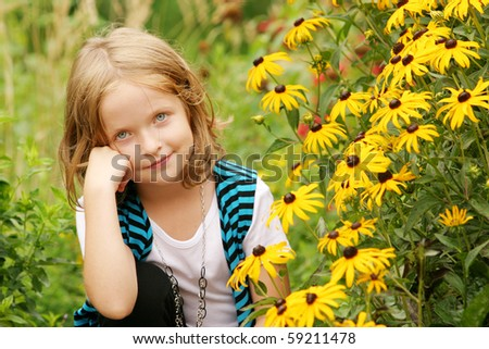 Young girl posing around flowers