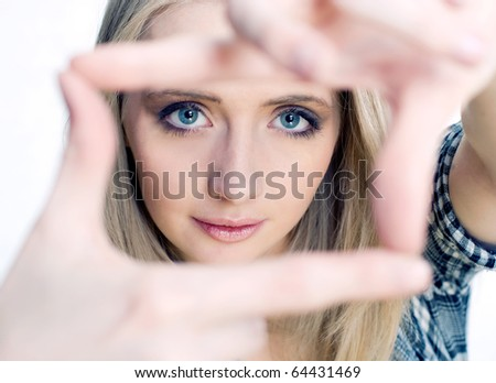 Young girl posing her hands like photo frame - stock photo