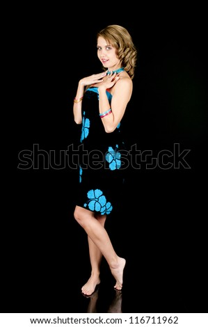 Young girl posing in a bikini and beach wrap/sarong after removing her dress. - stock photo
