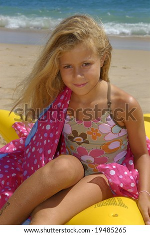 Young girl posing in the beach
