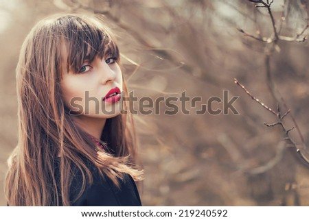 young girl posing in the forest  - stock photo