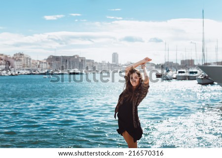 young girl posing in the port - stock photo