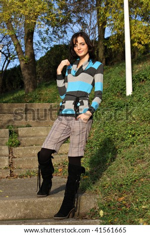 Young girl posing on stairs in the park