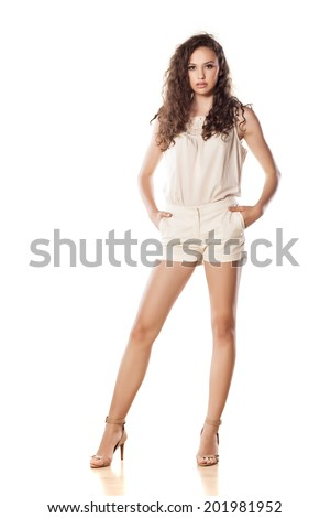 young girl posing on white background