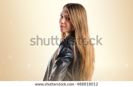 Young girl posing over ocher background