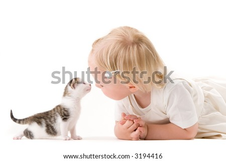 Young girl posing with kitten
