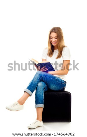 young girl reading book isolated on a white background