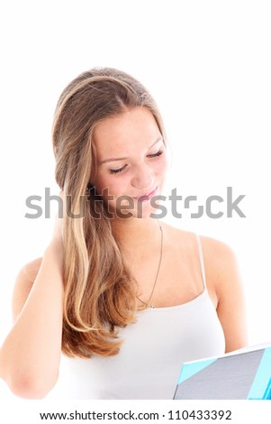 Young girl reading correspondence with a look of tender amusement as she enjoys the contents isolated on white