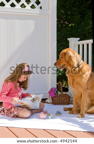 young girl reading to her dog