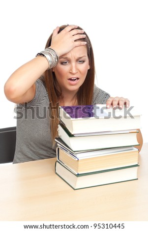 Young girl realizes how much she has to study, isolated on white